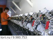 Купить «Engines from kart cars in row line for been inspected», фото № 9980753, снято 22 мая 2018 г. (c) PantherMedia / Фотобанк Лори