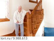 Купить «Senior lady with staircase», фото № 9988613, снято 26 марта 2019 г. (c) PantherMedia / Фотобанк Лори