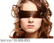 Купить «Portrait of woman covering eyes by her hair  », фото № 10009853, снято 23 января 2020 г. (c) PantherMedia / Фотобанк Лори