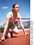 Купить «Image of young female ready to start running while on stadium», фото № 10021337, снято 20 января 2019 г. (c) PantherMedia / Фотобанк Лори