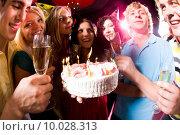 Portrait of seven persons holding glasses around cake with lights. Стоковое фото, фотограф Dmitriy Shironosov / PantherMedia / Фотобанк Лори