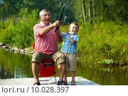Купить «Throwing fishing tackle», фото № 10028397, снято 15 сентября 2019 г. (c) PantherMedia / Фотобанк Лори