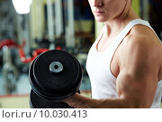 Close-up of sporty man training in gym with barbell . Стоковое фото, фотограф Dmitriy Shironosov / PantherMedia / Фотобанк Лори