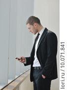 Купить «young business man talk by cellphone», фото № 10071841, снято 18 февраля 2020 г. (c) PantherMedia / Фотобанк Лори