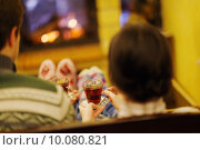 Купить «Young romantic couple sitting and relaxing in front of fireplace», фото № 10080821, снято 21 ноября 2019 г. (c) PantherMedia / Фотобанк Лори