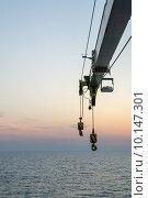 Стрела грузового крана на фоне моря. Стоковое фото, фотограф Марат Омарханов / Фотобанк Лори