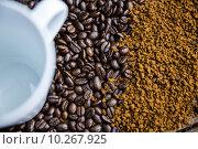 Купить «Coffee on a table with cup», фото № 10267925, снято 16 апреля 2015 г. (c) Wavebreak Media / Фотобанк Лори
