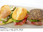 Купить «Three sandwiches with ham, tomato lettuce or cucumber, radish, cheese on a plate», фото № 10271757, снято 15 ноября 2019 г. (c) PantherMedia / Фотобанк Лори