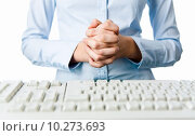 Купить «Image of female hands put together before her waist and with keyboard in front», фото № 10273693, снято 25 января 2020 г. (c) PantherMedia / Фотобанк Лори