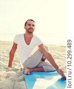 Купить «man doing yoga exercises outdoors», фото № 10299489, снято 6 августа 2014 г. (c) Syda Productions / Фотобанк Лори