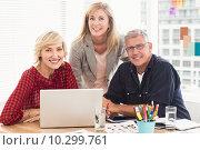 Купить «Smiling business team looking at the camera», фото № 10299761, снято 5 мая 2015 г. (c) Wavebreak Media / Фотобанк Лори