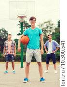 Купить «group of smiling teenagers playing basketball», фото № 10300541, снято 10 августа 2014 г. (c) Syda Productions / Фотобанк Лори