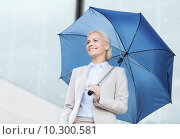 Купить «young smiling businesswoman with umbrella outdoors», фото № 10300581, снято 19 августа 2014 г. (c) Syda Productions / Фотобанк Лори