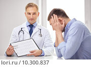 Купить «doctor and patient with cardiogram on clipboard», фото № 10300837, снято 10 мая 2014 г. (c) Syda Productions / Фотобанк Лори
