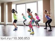 Купить «group of people exercising with barbell in gym», фото № 10300853, снято 5 апреля 2015 г. (c) Syda Productions / Фотобанк Лори