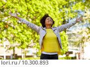 Купить «happy african american young woman in summer park», фото № 10300893, снято 4 июня 2015 г. (c) Syda Productions / Фотобанк Лори