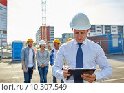 Купить «happy builders and architect at construction site», фото № 10307549, снято 21 сентября 2014 г. (c) Syda Productions / Фотобанк Лори