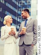 Купить «smiling businessmen with paper cups outdoors», фото № 10308581, снято 19 августа 2014 г. (c) Syda Productions / Фотобанк Лори