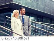 Купить «serious businessmen standing over office building», фото № 10308681, снято 19 августа 2014 г. (c) Syda Productions / Фотобанк Лори