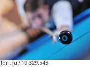 Купить «young man play pro billiard game », фото № 10329545, снято 26 марта 2019 г. (c) PantherMedia / Фотобанк Лори