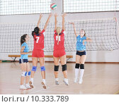Купить «girls playing volleyball indoor game», фото № 10333789, снято 23 февраля 2019 г. (c) PantherMedia / Фотобанк Лори