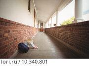 Купить «Sad pupil sitting alone on ground», фото № 10340801, снято 8 июля 2015 г. (c) Wavebreak Media / Фотобанк Лори