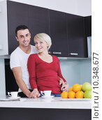 young couple have fun in modern kitchen. Стоковое фото, фотограф benis arapovic / PantherMedia / Фотобанк Лори