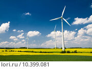 Купить «Windmills in the fields of yellow rape, renewable energy generators», фото № 10399081, снято 25 февраля 2020 г. (c) PantherMedia / Фотобанк Лори