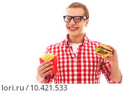 Купить «Funny man with french fries and hamburger», фото № 10421533, снято 12 декабря 2018 г. (c) PantherMedia / Фотобанк Лори