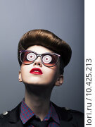 Купить «Funny Ridiculous Girl wearing Comic Sunglasses - Joke», фото № 10425213, снято 22 июля 2019 г. (c) PantherMedia / Фотобанк Лори