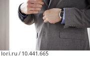 Купить «close up of man in suit fastening button on jacket», видеоролик № 10441665, снято 12 апреля 2015 г. (c) Syda Productions / Фотобанк Лори
