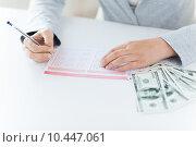 Купить «close up of hands with lottery ticket and money», фото № 10447061, снято 2 июля 2015 г. (c) Syda Productions / Фотобанк Лори