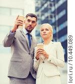 Купить «serious businessmen with paper cups outdoors», фото № 10449089, снято 19 августа 2014 г. (c) Syda Productions / Фотобанк Лори