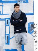 Купить «Handsome young man standing against graffiti covered wall», фото № 10464717, снято 18 февраля 2020 г. (c) PantherMedia / Фотобанк Лори
