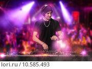 Купить «DJ is working at the disco», фото № 10585493, снято 18 октября 2018 г. (c) PantherMedia / Фотобанк Лори