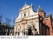 Купить «The Church of Saints Peter and Paul in the Old Town district of Krakow, Poland. This church including its statues were created in the 17th Century, no property release is required.», фото № 10603037, снято 19 марта 2019 г. (c) PantherMedia / Фотобанк Лори