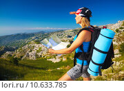 Купить «Active girl with map in the mountains», фото № 10633785, снято 19 октября 2018 г. (c) PantherMedia / Фотобанк Лори