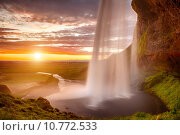 Купить «Seljalandsfoss is one of the most beautiful waterfalls on the Iceland. It is located on the South of the island. This photo is taken during the incredible sunset at approx. 1 AM.», фото № 10772533, снято 20 марта 2019 г. (c) PantherMedia / Фотобанк Лори