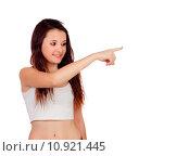Купить «Young teenage girl pointing at something», фото № 10921445, снято 16 ноября 2018 г. (c) PantherMedia / Фотобанк Лори