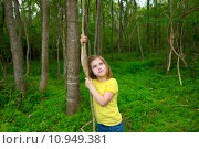 Купить «Happy girl playing in forest park jungle with liana», фото № 10949381, снято 21 апреля 2019 г. (c) PantherMedia / Фотобанк Лори