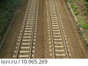 A pair of railway tracks viewed from above. Стоковое фото, фотограф Péter Gudella / PantherMedia / Фотобанк Лори