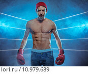 Купить «Young athletic boxer in a smoky background», фото № 10979689, снято 14 декабря 2017 г. (c) PantherMedia / Фотобанк Лори