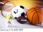 Купить «Assorted sports equipment», фото № 11047997, снято 25 апреля 2019 г. (c) PantherMedia / Фотобанк Лори