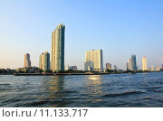Купить «Buildings along the river. The view from Asiatique. Attractions in Bangkok, Thailand.», фото № 11133717, снято 24 января 2019 г. (c) PantherMedia / Фотобанк Лори