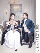 Купить «Молодая пара в средневековой одежде», фото № 11211305, снято 23 августа 2015 г. (c) Darkbird77 / Фотобанк Лори