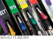 Купить «Заправочные пистолеты с бензином разного октанового числа и дизельным топливом для автомобилей», фото № 11262553, снято 27 июля 2015 г. (c) Николай Винокуров / Фотобанк Лори