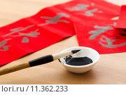 Купить «Writing the couplet for chinese new year», фото № 11362233, снято 26 мая 2020 г. (c) PantherMedia / Фотобанк Лори
