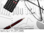 Купить «business finance charts with pen, glasses and calculator», иллюстрация № 11371845 (c) PantherMedia / Фотобанк Лори