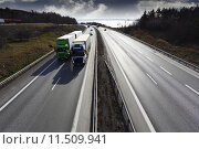 Купить «giant motorway, wide perspective with trucks driving», фото № 11509941, снято 25 мая 2019 г. (c) PantherMedia / Фотобанк Лори