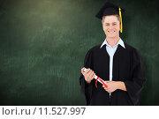 Купить «Composite image of man smiling as he has just graduated with his degree», фото № 11527997, снято 20 августа 2018 г. (c) Wavebreak Media / Фотобанк Лори